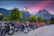 Ride the Alps - Poker Run / Turn a trip into a journey with the annual military motorcycle rally sponsored by Exchange New Car Sales. Hike your leg over your ride and discover the most scenic roads in Bavaria. Rumble through Bavarian villages, breathtaking mountain passes, and endless vistas where the road varies as much as the local languages. After the ride, join fellow bikers in friendly (new) competitions, parties, live entertainment and traditional Bavarian fest.