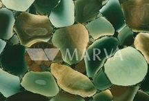 PRECIOUSTONE / Semi Precious Stone Surfaces are made from specially selected natural and solid semi precious pieces such as Quartz, Amethyst and Agate, hand composed and bound together using special resin. This collection is mainly recommended for cladding, countertops, bar, vanities, murals, etc. Harder stone can be used for flooring.