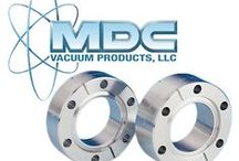 Vacuum Flanges and Fittings / MDC established its standing in the vacuum components world after becoming one of the first licensed manufacturers of Varian's patented Conflat® metal-seal flange, known today to most MDC customers as the Del-Seal™ CF metal-seal flange.