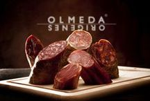 Cold Meats Embutidos Olmeda Origenes / Cold meats from Iberian black pig or Serrano white pig. We have selected this collection of cured meat from all regions of Spain, Andalusia, Catalonia or Castile. They are made with natural and native ingredients, which depend on the region, every artisan has his own method to prepare his cold meat, Spanish paprika, black pepper, rosemary are some the most used spices, them they are cured for a long time in natural cellars until they get their optimum state.