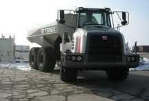 Wheeler Truck Rebuilds / Did you know that Wheeler can repair most makes and models of machines? This Terex articulating dump truck needed to be steam cleaned; spot sand blasted, and had some cracks in the fiberglass hood that needed repair. It was masked, coated in primer, and then we applied Urethane paint as well as the decals provided by the customer.