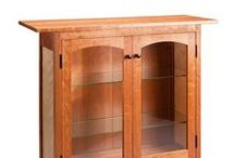 Cherry Display Cabinet / Display your collectibles in this beautiful solid wood, handcrafted display cabinet. Joinery is mortise, tenon and pegged. Finish is two coats of lacquer. Dimensions: 40.0in H x 40.0in W x 13.5in D $2,495.00