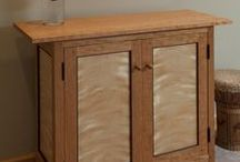Side Cabinet /  This unique handcrafted side cabinet is made of solid cherry, flame birch panels and wenge trim. This piece will accent any room of your home nicely. Joinery is mortise & tenon and pegged. Finish is two coats of lacquer. Dimensions: 32.0in H x 32.0in W x 12.0in L $1,995.00