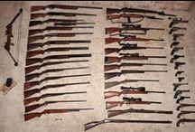 rifles and pistols and shotguns