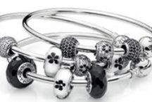 PANDORA Bangle! / For the first time, PANDORA is proud to debut our new, customizable, sterling silver bangle bracelet. Add clips, charms and Murano glass and give way to new stories, creation and combinations! The new sterling silver bangle has a round barrel lock that works in the same way as the PANDORA clasp. Stack multiple bangles (alone or with charms) for a truly stunning look.