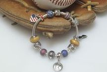 Team Pride! / From little league to professional league, ballparks, domes, fields, arenas, rinks and more, we show our support with PANDORA charms!