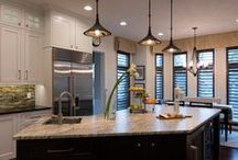 Kitchen Remodels / Custom cabinetry, granite counters, pendant lighting, apron sink, kitchen island, stove, oven