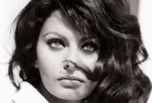 Sophia Loren / Sofia Villani Scicolone (September 20, 1934) is an Italian film actress. She has won an Academy Award, Grammy Award, five special Golden Globes, a BAFTA Award, a Laurel Award as well as the Honorary Academy Award in 1991. In 1995, she received the Cecil B. DeMille Award for lifetime achievements, one of many such awards. / by Carlito Rashad