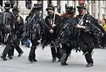 Tattered ~ Morris Dancing / {Border Morris} It was originally performed by farm labourers in the winter months to supplement their income when there was no work. Unfortunately it was classed as a form of begging which was illegal at the time (1800's) & so in order to stay one step ahead of the law the dancers & musicians would wear disguises.  They would 'black up', which means rubbing soot and charcoal over their faces to hide their identities. They would wear 'tatters' which are long coats adorned with rags.
