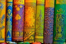 Book Reviews / A written or printed work consisting of books and pages glued or sewn together along one side and bound in covers.
