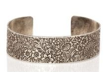 Engraved Bracelets / Few models of engraved bracelets and bangles. Written words and drawings on metal jewelry.
