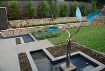 PRODUCTS: Features / This board includes landscape features such as decprative panels, sculptures and fire pits