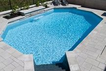 Onground Swimming Pools by Pioneer Family Pools / The onground pool option is a great option for sloped backyards and is a cost effective choice.