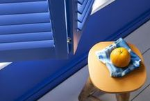 Lindos Blue / Make the most of your shutters by painting them a deep, royal blue, creating a beautiful design counterpoint for your windows.
