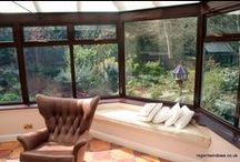Redgrove Park 2005 / This conservatory was built on a little-used area of the garden (the customer called it 'dead space' ). It is a good example of how a featureless part of the garden can not only be transformed, but can actually enhance the whole property. In fact, the customer was so happy with the overall effect that he commissioned a small additional bay modifiying the kitchen. This was he can now survey the garden and his new conservatory while his wife oversees him doing the washing up.