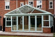London 2009 / This conservatory spans the whole width of the living area (the building is separated into three properties). The owner wanted as large and spacious a structure as possible; but one that did not look as though it had been 'plonked' onto the building as an afterthought. He also wanted to be involved with the build itself - he's the one in the red trousers!