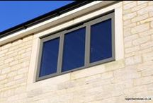 Swindon Lane Cheltenham 2014 / This is the third project Regent Windows has completed for a local business man, this is a SIP build with stone on the front elevation and render to the rear also a 2m x 1m glass lantern to the rear above the kitchen