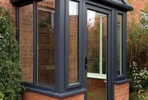 Charlton Kings, 2014 / Woodgrain foiled PVCu porch frame and roof (Anthracite Grey). Customer built his own base and we fitted the rest.