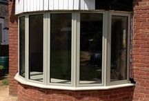 Gotherington, 2014 / RAL 7032 (Pebble grey) on white aluminium windows and bifolding door