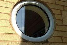 Painswick 2014 / French Grey uPVC on Woodgrain and aluminium bi-folding doors