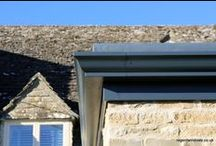 Rendcombe 2015 / Aluminium textured dark grey 1 four pane bi-folding door without handle on the out side and 1 three pane bi-folding door with traffic door and external handle. Roof lantern in RAL 7016