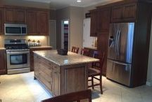 Open Kitchen Design in Alpharetta, GA / A wall and pantry were removed from the kitchen to enlarge the space. This allowed for the addition of an island.