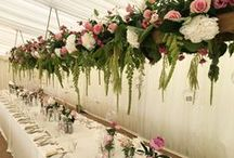 Harriet & Sebastian 2016: Helmingham Hall / Overflowing hanging ladders with copious amounts of luscious flowers, milk bottles jars scattered on the tables and a venue with a WOW factor on a summers day!