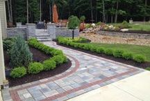 Paver Borders & Accents / Precision Corporation uses a variety of landscaping paver bricks to create amazing accents that beautify the home and yard.