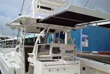 Center Console/Sportfishing Boats / Retractable shade for center console and offshore sportfishing boats. With SureShade, canvas is easily extended beyond the center console helm to provide sun protection in the aft cockpit or forward bow area of the boat.