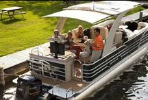 Pontoon Boats / Pontoon style boats with SureShade retractable sunshade systems that extend canvas at the touch of a button