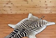 Animal Skins and Rugs at Safariworks Taxidermy Sales / Animal skin rugs look great displayed as a wall hanging or on the floor in front of the fireplace. A taxidermy rug is an ideal way to show off the beauty of the animal. We carry a large selection of zebra, mountain lion, wolf and grizzly bear rugs as well as skins and hides from exotic deer and African species.