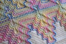 Needlework: Huck / Swedish Weaving is also known as Huck Embroidery. This needle art became popular in the late 1940's.  Homemakers decorated the borders of Huck towels with embroidery floss.  Today, crafters make couch throws, baby blankets, pillows, wall hangings, pictures, and table linens using yarn and Monk's Cloth.  They also enjoy using a variety of threads on other even-weave fabrics, such as Huck cloth, Huck Fabric, Huck towelling, Waffle Cloth and Afghan Canvas.
