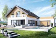 HomeKONCEPT 1 | Projekt domu / HomeKoncept 1 jest domem o ciekawej, nowoczesnej linii i niezwykle funkcjonalnym wnętrzu. Z zewnątrz uwagę przyciągają ciekawa elewacja - neutralne kolory materiałów wykończeniowych zestawione z ciepłą barwą drewna podkreślają ciekawą bryłę domu, która idealnie wpisuje się w niemal każde otoczenie. #HomeKONCEPT #architektura #projektydomow #projektydomównowoczesnych #wnętrzakoncept