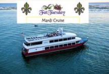 """Mardi Gras Fat Tuesday Destin Fla Dinner Party Cruise / Let the good times roll as you cruise through Fat Tuesday on the SOLARIS for the ultimate Mardi Gras celebration in Destin Florida. Sip on hurricanes and feast on a Lundi Gras appetizer of fresh baked rosemary bread & infused oil with a Muffuletta Pasta Salad. """"Bouef Gras"""" Entree Choices include Louisiana Red Beans and Rice, Cajun Jambalaya or Blackened Gulf Fish. End the night with a SOLARIS King Cake."""