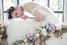 Wedding Dresses - White Gowns / Each of our white gown is a gem on it's own, be it the graceful mermaid silhouette, glamorous trumpet trains or the ever-so-popular classic ball gowns and A-lines, we are a wedding boutique in Singapore that is all about timeless romance and femininity...