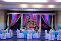 Bollywood Theme Decorations / NEW design Wedding Mandap, with Bollywood Theme Decorations (Including lighting) and our new Table Centerpieces which gives very stunning richness to the place. New direction to the next stage of our business, we always try to make our customers dream come true.