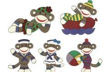 Sock Monkey Design Sets / These adorable fun-loving monkeys will be great on any whimsical project you are working on! They celebrate everything from Christmas to Halloween! Available in both applique and filled stitch, and for instant download 24/7 #DesignsbyJuJu