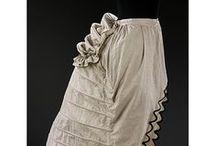 Bustle Era Undergarments / Bustle Era underclothes, 1868-1889: chemises, shifts, drawers, petticoats, princess petticoats, bustle supports, bustle pads, etc. / by Old Petticoat Shop