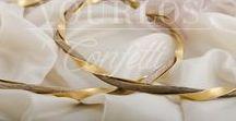 Wedding Crowns - Στέφανα /  Στην βιοτεχνία μας συνεργαζόμαστε με τους καλύτερους επαγγελματίες και διαθέτουμε μεγάλη ποικιλία σε χειροποίητα πάντα στέφανα,ξύλινα, επάργυρα, επίχρυσα, πορσελάνινα, ασημένια, δερμάτινα,με πολύτιμα swarofski, αποξηραμένα άνθη, πέρλες, κρύσταλλα, και με ημιπολύτιμους λίθους. Διαθέτουμε επίσης χειροποίητες και πρωτότυπες στεφανοθήκες.