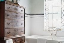 Master Bath / Bookcase. Chair. Laundry hamper. Towel basket. Hooks. Faux white octopus