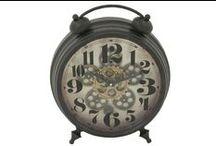 Clocks / Find more at LivingSpaces.com.