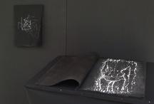 Serie Ego / una serie de grabados que se van desvaneciendo hasta el negro mas catártico estructurados por la envoltura mimética de un libro antiguo