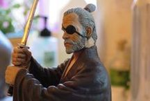 Commemorative figure / I had a custom figure made by Sillof to celebrate Sifu Waller's 41 years of unbroken martial arts training. My specifications were simple: Sifu Waller as an old man, A feudal era ronin, Wielding a sword, Mean-looking; ruthless, Blue eyes, high forehead, scowling, Scarred, (wounded?) and still serious. What do you think? I wanted something unique and personal to commemorate Sifu's dedication. (Rachel, 2016)
