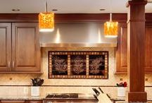 KITCHEN REMODEL: A Cook's Kitchen / Brownstone stained kitchen cabinets, Venetian Cream and Brandy Yellow granite countertops, double ovens, tiled backsplash with copper and cream, a grandious center island, and quality appliances make this kitchen a cook's dream.