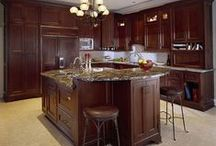 KITCHEN Remodel: Grand Scale / Cabinets with architectural detailing and scale met the 10' ceiling to best effect.  Mahogany cabinets with inset doors reflect classic nature of home.  Center island serves as a multifunction area.
