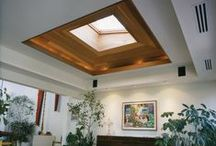 SUNROOM & LIVING ROOM / Beautiful sunroom topped off with an enormous skylight with wood molding.