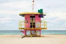 lifeguard stands in miami / Of the 29 stands 16 occupy the South Beach portion of the sand. Two of these were part or the original five whimsical stands designed by William Lane Architect in 1995 after Hurricane Andrew. Today several of the original stands have been retired to a parking lot behind the Miami Beach Convention Center.