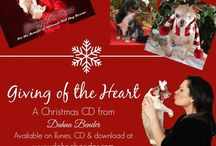 Giving of the Heart Christmas CD / 'Giving of the Heart' Christmas CD by Dahna Bender was developed to support National Mill Dog Rescue, with all profits being donated directly to the organization in support of their efforts to rescue, rehabilitate and rehome discarded puppy mill breeding dogs.