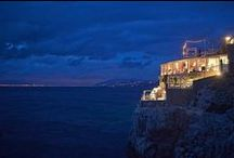 """Il Riccio Restaurant & Beach Club / Only a few steps from the enchanting Blue Grotto, Il Riccio-awarded with a Michelin star in 2013- offers a unique location overlooking the sea. Chef Salvatore Elefante likes to define its own cuisine """"ally of the sea"""", preferring fish, seafoods and specialties typically Mediterranean."""
