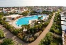 Villaggio A Mare / The Village, very close to the sea, is situated around a big central swimming pool that keeps a wide zone secure for the kids, a whirlpool zone, and a very big solarium with sunbeds and sun chairs.